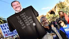 A man holds an effigy of Italian Interior minister and deputy PM, Matteo Salvini,
