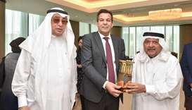 HE Sheikh Faisal presenting a souvenir to Djellab as Hussain Alfardan looks on.