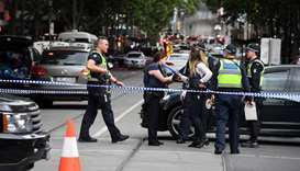 Police work at the crime scene following a stabbing incident in Melbourne