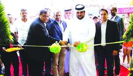 Sheikh Hamad bin Jassim MA al-Thani and Peter Mathews lead the ribbon-cutting ceremony to open the f