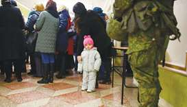 A serviceman guards voters at a polling station in Donetsk, in the rebel-held area of eastern Ukrain