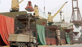 A shipment of grain is unloaded at the Red Sea port of Hodeidah