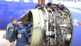 NTSB investigators examining damage to the engine of the Southwest Airlines plane