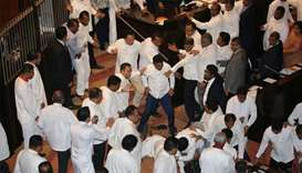 Scuffles between Sri Lanka's parliament members are seen during the parliament session in Colombo