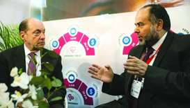 CEO of Qatar Charity (QC) Yousef bin Ahmed al-Kuwari talking to an official at the AidEx 2018 event,