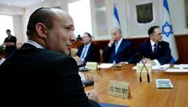 Israeli Education Minister Naftali Bennett (L) attends the weekly cabinet meeting at the prime minis