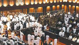 Sri Lankan police (right) gather to escort Parliament Speaker Karu Jayasuriya in the assembly hall a