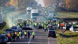 People wearing yellow vests, a symbol of a French drivers' nationwide protest against higher fuel pr