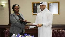 Hassad Food CEO Mohamed Badr al-Sadah and Rwanda Development Board CEO Clare Akamanzi shake hands af