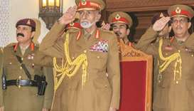 Sultan Qaboos presides over National Day military parade