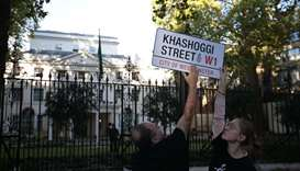 "A mock street sign reading ""Khashoggi Street"" is erected by Amnesty International activists on the s"