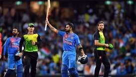 India's batsman Virat Kohli celebrates his team's victory against Australia in a T20 international c