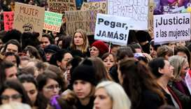 People attend a rally against gender-based and sexual violence against women in Madrid, Spain