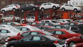 Newly built cars sit in a shipping lot near General Motors Car assembly plant in Oshawa