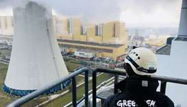 A Greenpeace activist after he climbed a 180 metre-high chimney at Poland's Belchatow coal-fired pow