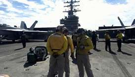 Crew members of the US Navy aircraft carrier USS Ronald Reagan conduct military drills during Keen S