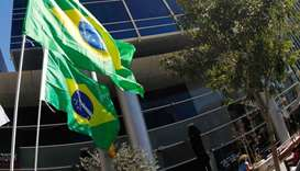 Brazilian flags hang outside the building housing the offices of the Brazilian Embassy