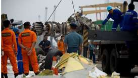 Indonesian rescue personnel unload a recovered engine from the ill-fated Lion Air flight JT 610 at a