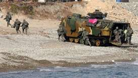 South Korean Marines exit an amphibious assault vehicle on a beach during a landing operation in the