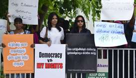 Sri Lankan activists hold placards during a demonstration in Colombo yesterday.