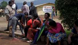 Parents await for news of their children at a school where 79 pupils were kidnapped in Bamenda, Came