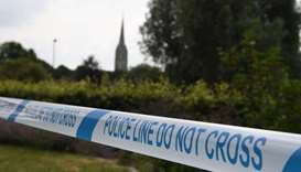 The spire of Salisbury Cathedral is seen behind police tape making a cordon around Queen Elizabeth G