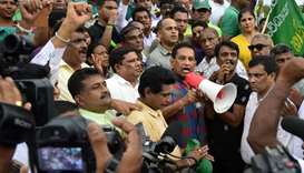 Sri Lankan politician Rajitha Senaratne (C) addresses a rally of supporters of deposed prime ministe