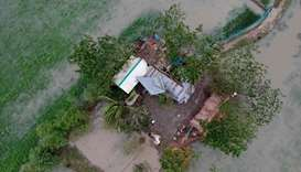 An aerial photo taken today shows a destroyed house after cyclone Bulbul hit the area in Koyra, some