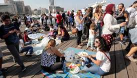 Lebanese demonstrators gather and picnic at Beirut's Zaitunay Bay during a protest against the priva