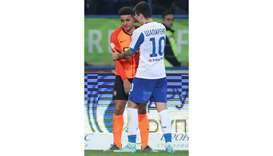 Dynamo Kiev's Mykola Shaparenko (right) consoles Shakhtar Donetsk's Taison, who was racially abused