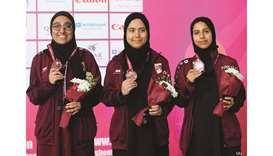 Qatar's Fatima Saeed al-Muraikhi, Ghalia Ali al-Malki and Amna Ali al-Shirawi pose with their women'