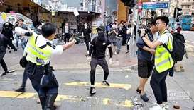 Hong Kong spirals into rare daylight violence as police shoot protester