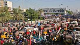 Iraqi protesters gather at Tahrir square during ongoing anti-government demonstrations in the capita