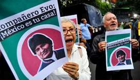People demonstrate in support of Bolivian ex-President Evo Morales in front of the Bolivian embassy