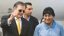 Mexican Foreign Minister Marcelo Ebrard (left) receives Bolivian ex-president Evo Morales upon his a