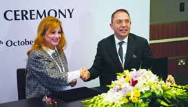 Meeza's Ghada Philip el-Rassi and NGN's Inanc Erol shake hands after signing the MoU.