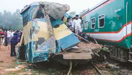 Bystanders look on after a train collided with another train in Brahmanbaria, some 130km from Dhaka,