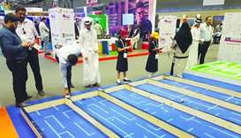 Young visitors try some of Edutech's interactive activities and games at Qitcom 2019