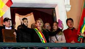 Bolivian Senator Jeanine Anez gestures after she declared herself as Interim President of Bolivia, a