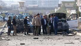 Security personnel and investigators gather at the site of a suicide attack in Kabul