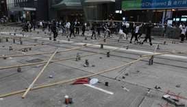 Protesters blockade universities, business district as chaos grips Hong Kong