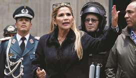 Bolivian interim president Jeanine Anez takes part in a ceremony with the police in front of the Pre