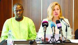 Steinerte speaks at a press conference as Adjovi looks on in Doha