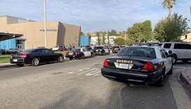 A general view of first responder vehicles outside Saugus High School after a shooting at the school