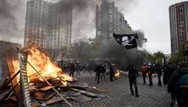 "A protesters hold a pirate flag on place d'Italie in Paris during a demonstration of the ""yellow ves"