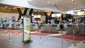 Empty SAA (South African Airways) check-in counters are seen at the O.R. Tambo International Airport