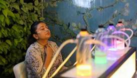 A Delhi resident breathes in oxygen mixed with aromatherapy via a nasal cannula, at an oxygen bar in