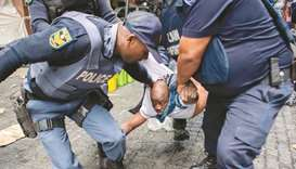 An October 30, 2019, file photo of South African police officers forcibly removing refugees camping