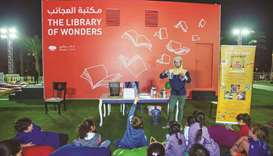 Children interact with a host during a session of activities at Doha Learning Days.
