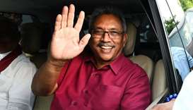Sri Lanka's President-elect Gotabaya Rajapaksa waves at supporters as he leaves the election commiss